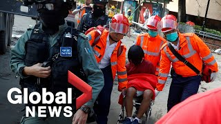 Hong Kong campus siege: Medics bring out injured protesters from university as schools reopen
