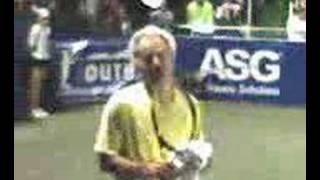 John McEnroe wails on a fan