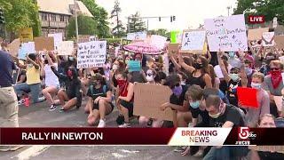 Demonstrators block Washington Street in Newton
