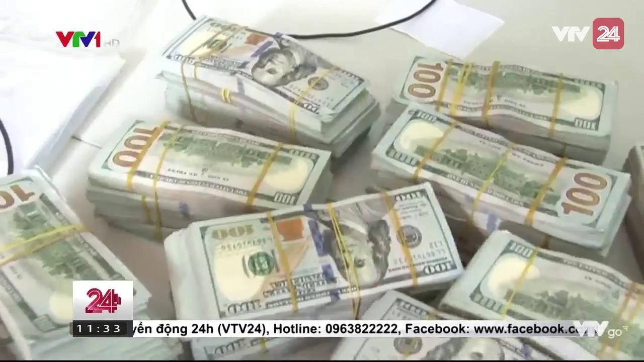 Bắt gần 1 triệu USD tiền thật buôn lậu vào Việt Nam - Tin Tức VTV24