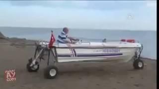 Tekneyi Karada yürüten adam Türk Mucid