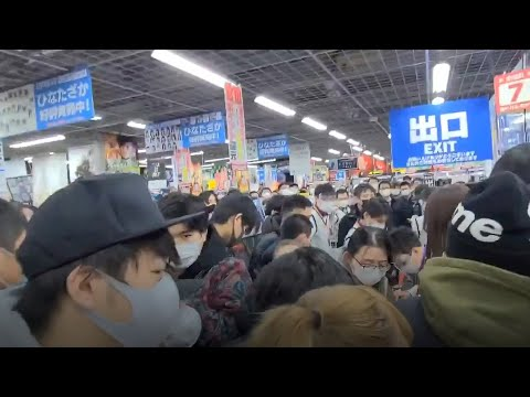 Chaos in Japan as crowds rush to buy PS5 - despite surge of Covid cases