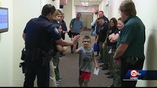 Blue Springs police line the hospital's hall to support boy who supported them