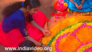 Pookalam Rangoli floral decorations with flowers Onam Video greetings Kerala