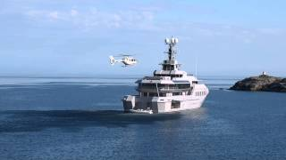 Helicopter landing on Private yacht 'Skat' docked in Nusfjord.