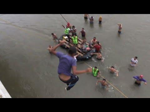 Migrants jump into river from border bridge to reach Mexico
