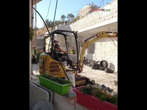 Israeli occupation forces demolish a Palestinian house