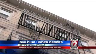 Building under orders; owner has long history of violations