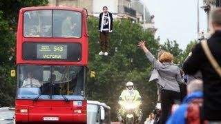Magician Dynamo levitates on side of London bus