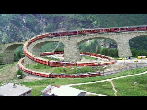 Switzerland train on Europe's beautiful brusio spiral loop railway viaduct in Switzerland, eu (1/3)