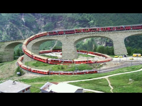 Swiss train in Brusio spiral loop railway viaduct, Switzerland, 2k18 | shock wave