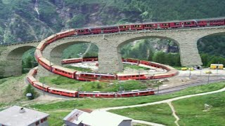 Switzerland train on Europe's beautiful brusio spiral loop railway viaduct in Switzerland, eu (1/3) thumbnail