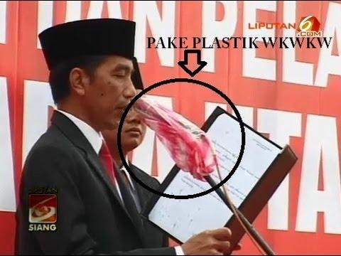 LUCU !! Mik Jokowi Dibungkus Plastik Saat Lantik Walikota