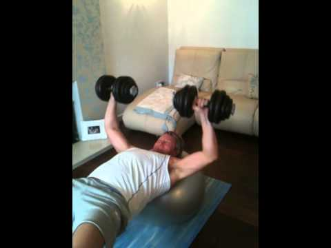 Personal Training, Bristol. Client performing 30kg DB fitball chest press into pushups