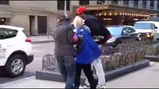 Elderly Woman Blown Away by Wind in Chicago