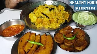Eating Healthy Food ( Khichdi)