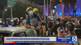 Protesters take to streets in downtown Los Angeles after grand jury decision in Taylor case
