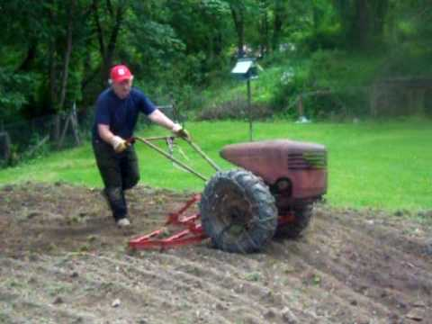 David Bradley Tractor at work With 4  Attachments