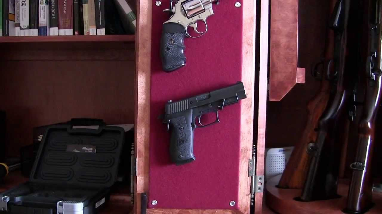 Hanging pistols inside gun cabinet  YouTube