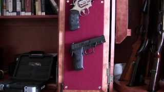 Hanging Pistols Inside Gun Cabinet