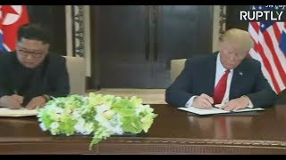 Trump & Kim sign 'historic' documents (streamed live)