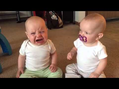 Thumbnail: Twin baby girls fight over pacifier