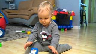 Baby easily amused by old toy