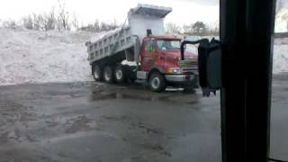 Sterling Triaxle Dumptruck Dumping Snow