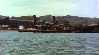 A Japanese midget submarine base and several Japanese riverboats underway on a ri...HD Stock Footage