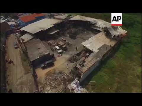 Drone footage of fireworks factory fire in Indonesia