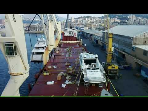 Cross Chartering Yacht Transport Loading at Port of Genoa, Italy.