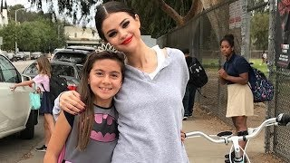 Gomez kicked off the week by taking a casual bike ride past studio city, ca, high school. in case students didn't recognize celebrity as she rode by, h...