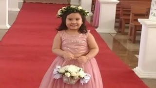 Haley walking down the aisle as a FLOWER GIRL!