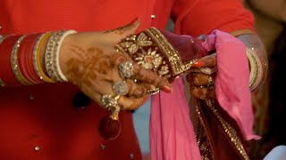 Performing gathbandhan wedding ritual which signifies togetherness of bride and groom