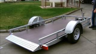 Autoflex hydraulic lowering system for trailer