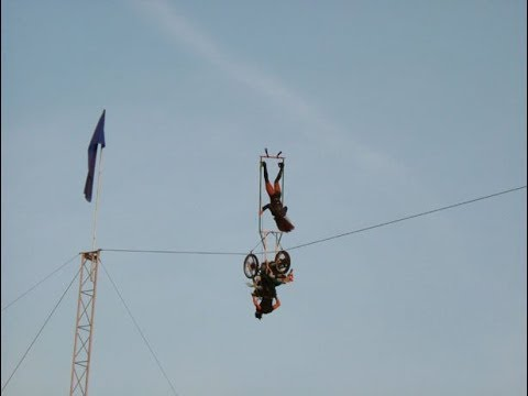 Motorbike on High wire Circus Act Dangerous Skills Extreme Entertainment