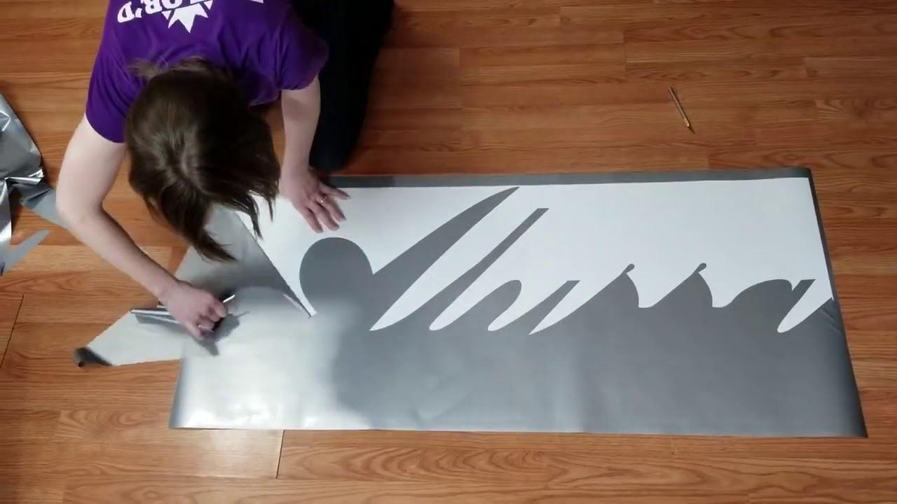 Download Weeding a large floor vinyl graphic