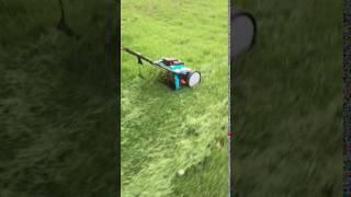 Gardena 4025 U cordless mmower in tall grass