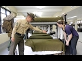 U.S. Marine tries to teach reporter how to make a military-style bed