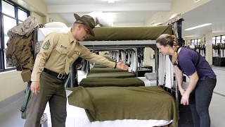 U.S. Marine tries to teach reporter how to make a military-style bed thumbnail