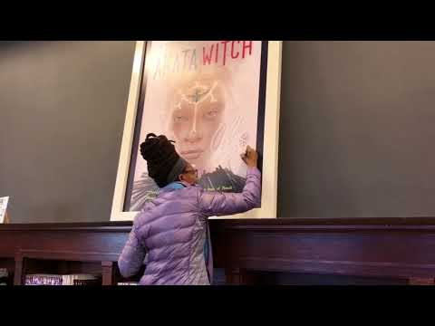 "Author Nnedi Okorafor Signs Her ""Akata Witch"" Poster"