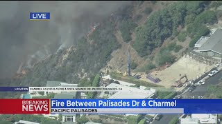 Flames Burn Near Hilltop Homes In Pacific Palisades