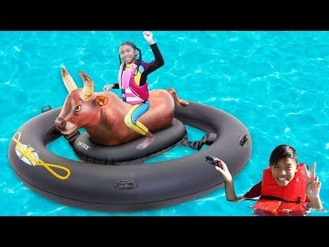 Wendy Plays in the Pool on Inflatable Bull Toy