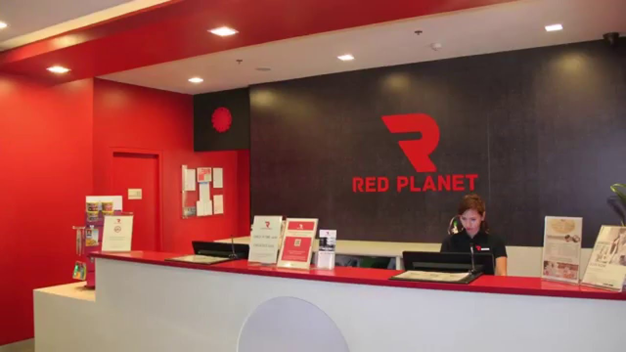 Red planet hotel ortigas center review by wow philippines for Travel agency office interior design ideas