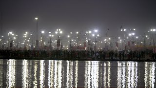 Lights of Kumbh Mela reflecting in the water of river Ganga at Indian festival