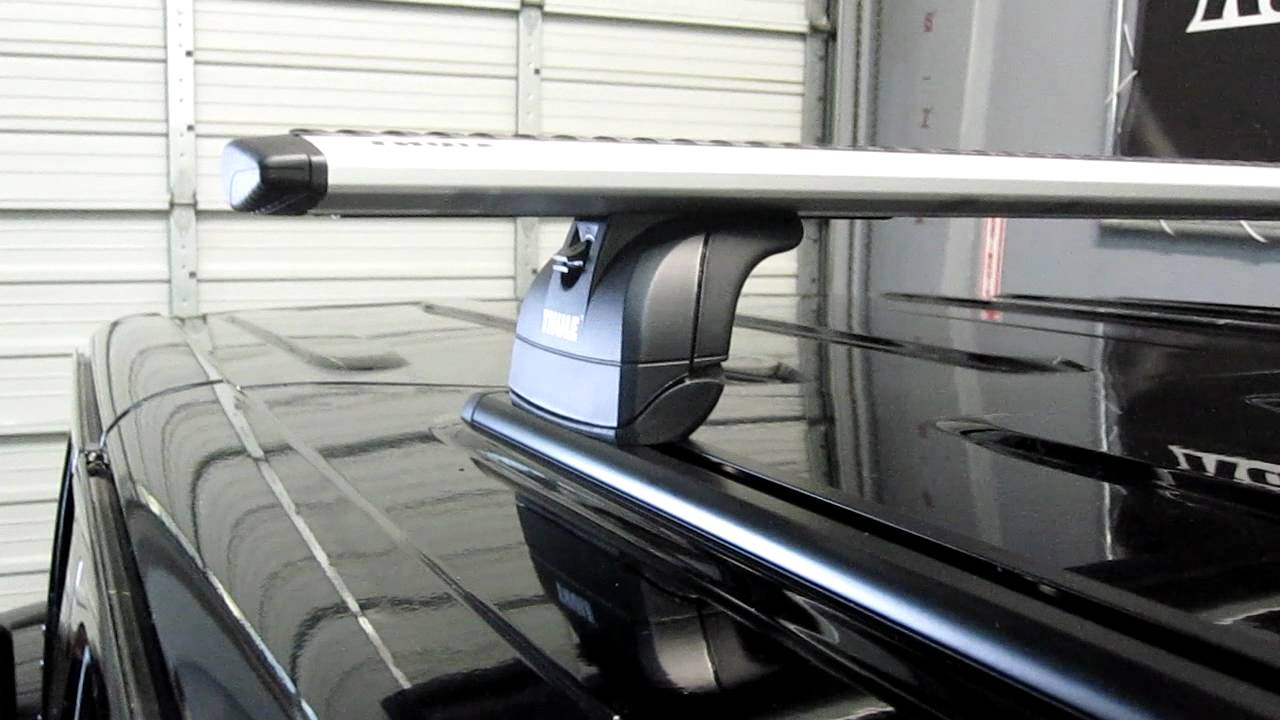 Jeep Wrangler Unlimited With 460R Podium AeroBlade Roof Rack On Tracks By  Rack Outfitters
