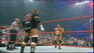 Christian w/Triple H  vs Dave Batista