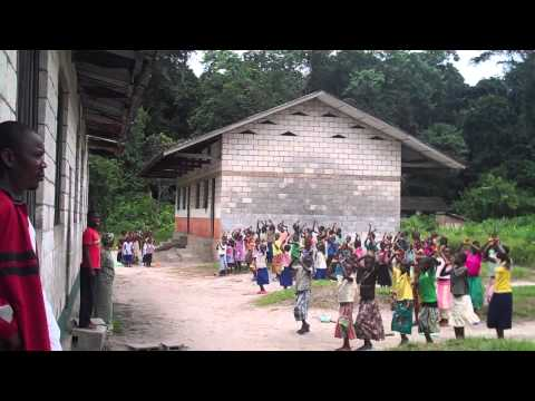 Basankusu: Waka, DR Congo - school children exercise before lessons