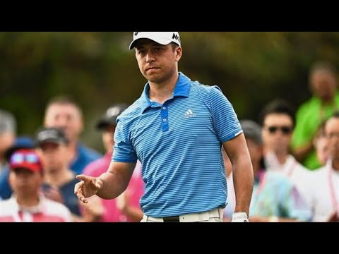 Australian Smith takes first round lead in sweltering heat
