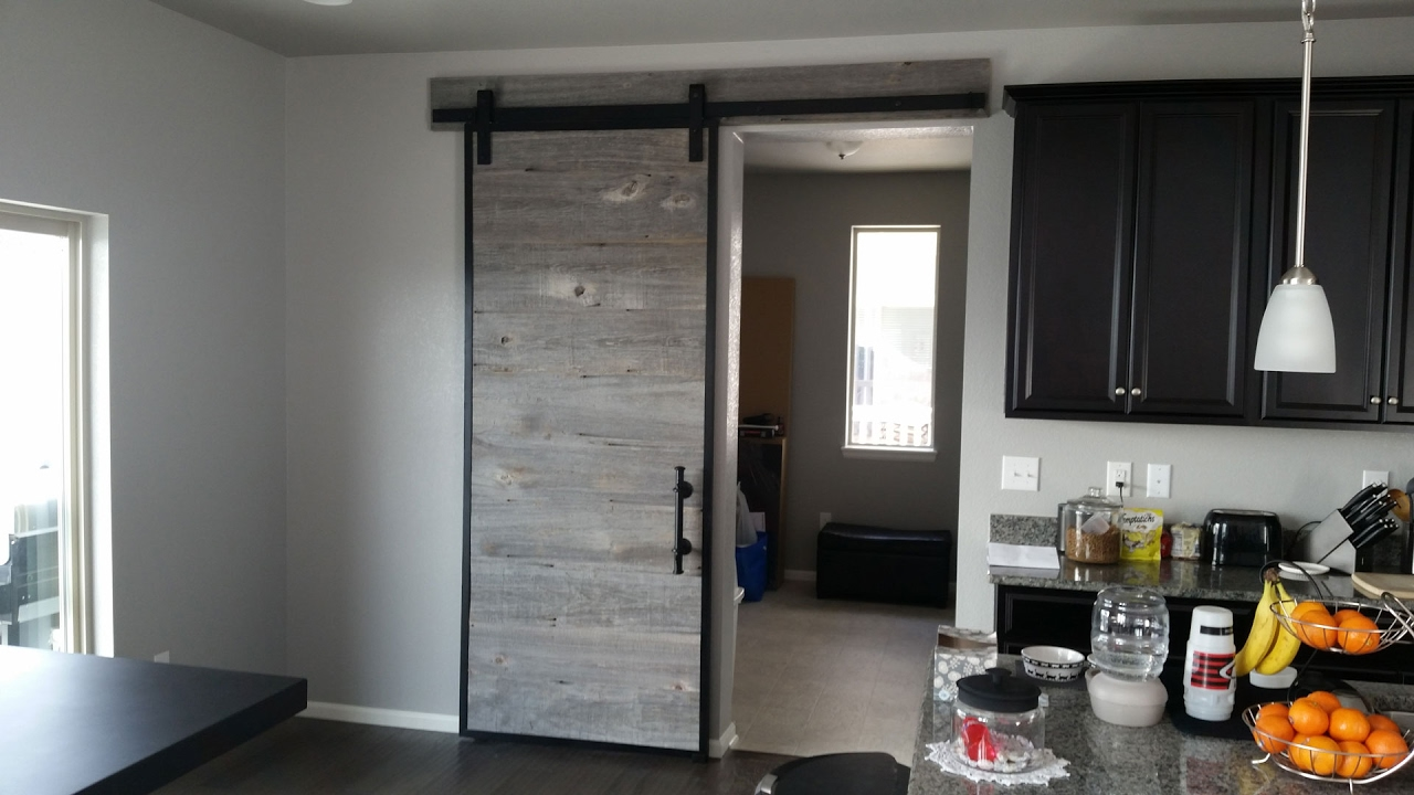 Building a barn door using reclaimed barn wood in a steel for Metal barn doors